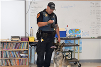Fourth-graders visit with four-legged protectors photo